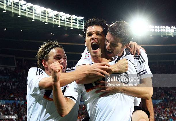 Michael Ballack of Germany celebrates with team mates Clemens Fritz and Arne Friedrich after scoring the opening goal during the UEFA EURO 2008 Group...