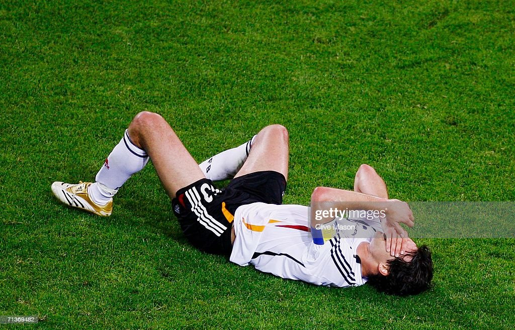 Michael Ballack of Germany clutches his face during the FIFA World Cup Germany 2006 Semi-final match between Germany and Italy played at the Stadium Dortmund on July 04, 2006 in Dortmund, Germany.