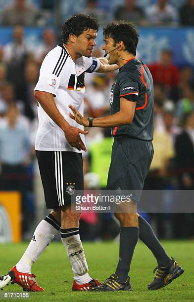 Michael Ballack of Germany confronts referee Massimo Busacca of Switzerland during the UEFA EURO 2008 Semi Final match between Germany and Turkey at...