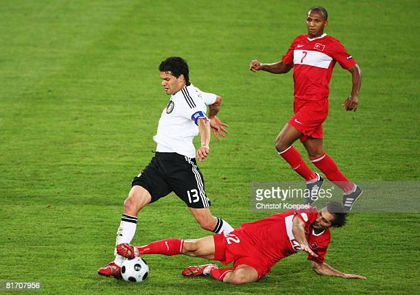 Michael Ballack of Germany fights for the ball with Hamit Altintop during the UEFA EURO 2008 Semi Final match between Germany and Turkey at St...