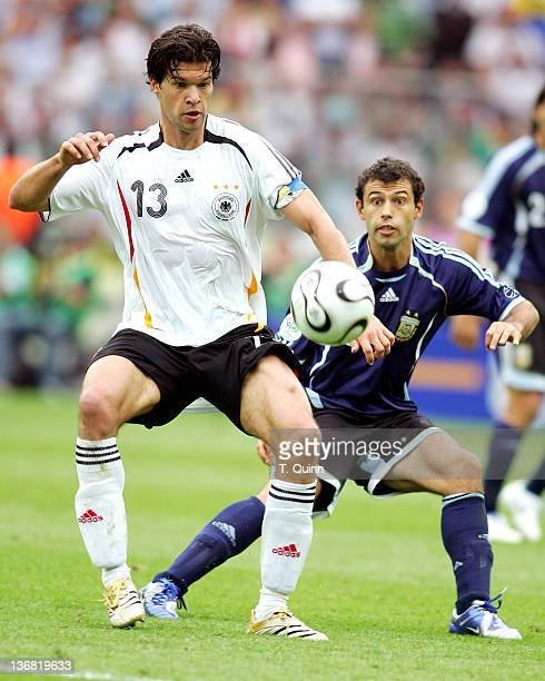 Michael Ballack of Germany gets to the ball before Javier Mascherano of Argentina during their quarterfinal match at the Olympiastadion in Berlin...