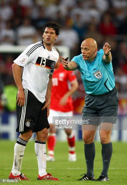 Michael Ballack of Germany grimaces as referee Tom Henning Ovrebo awards a free kick during the UEFA EURO 2008 Group B match between Germany and...