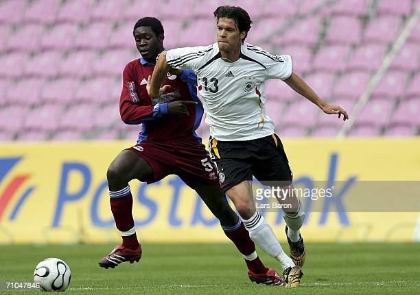 Michael Ballack of Germany in action with Swan Nzay of Genf during the test match between the A Juniors of Servette Geneva and the German National...