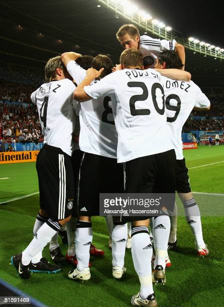 Michael Ballack of Germany is congratulated by team mates after scoring the opening goal during the UEFA EURO 2008 Group B match between Austria and...