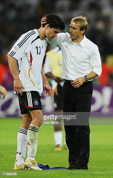 Michael Ballack of Germany is consoled by Manager Juergen Klinsmann following their team's defeat at the end of the FIFA World Cup Germany 2006...