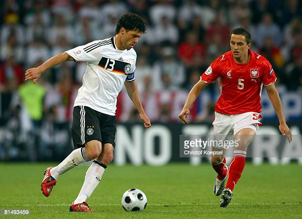 Michael Ballack of Germany looks to pass under pressure from Dariusz Dudka of Poland during the UEFA EURO 2008 Group B match between Germany and...