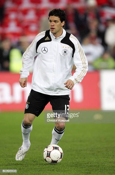 Michael Ballack of Germany runs with the ball before the international friendly match between Switzerland and Germany at the St JakobPark on March 26...