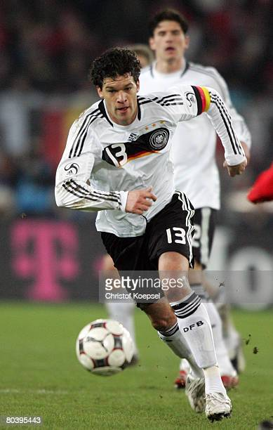 Michael Ballack of Germany runs with the ball during the international friendly match between Switzerland and Germany at the St JakobPark on March 26...