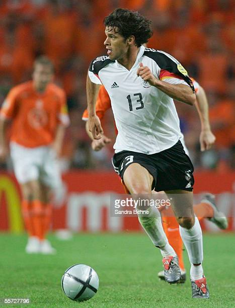 Michael Ballack of Germany runs with the ball during the UEFA Euro 2004 Group D match between Germany and Netherlands on June 15, 2004 in Porto,...