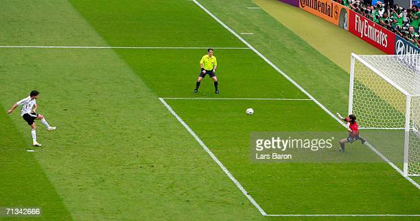 Michael Ballack of Germany scores a penalty past Leonardo Franco of Argentina in a penalty shootout during the FIFA World Cup Germany 2006...