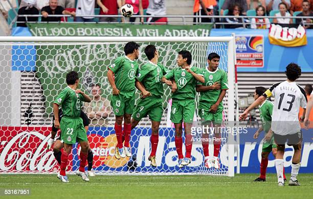 Michael Ballack of Germany scores by free kick against the Mexican wall the seventh goal during the game between Germany and Mexico for the third...