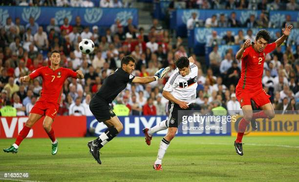 Michael Ballack of Germany scores his team's third goal during the UEFA EURO 2008 Quarter Final match between Portugal and Germany at St JakobPark on...