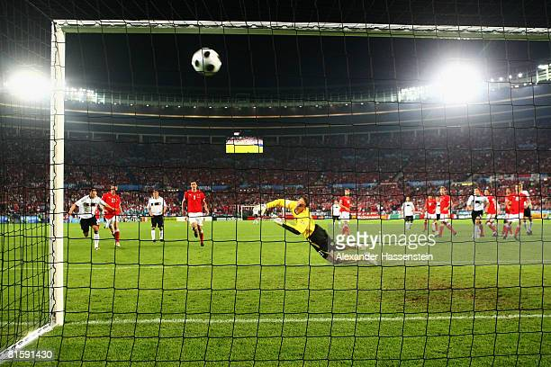 Michael Ballack of Germany scores the opening goal during the UEFA EURO 2008 Group B match between Austria and Germany at Ernst Happel Stadion on...
