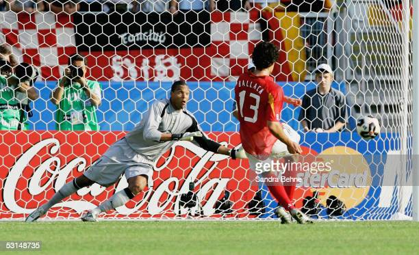 Michael Ballack of Germany scores the second goal from the penalty spot during the Semi Final match between Germany and Brazil in the FIFA...