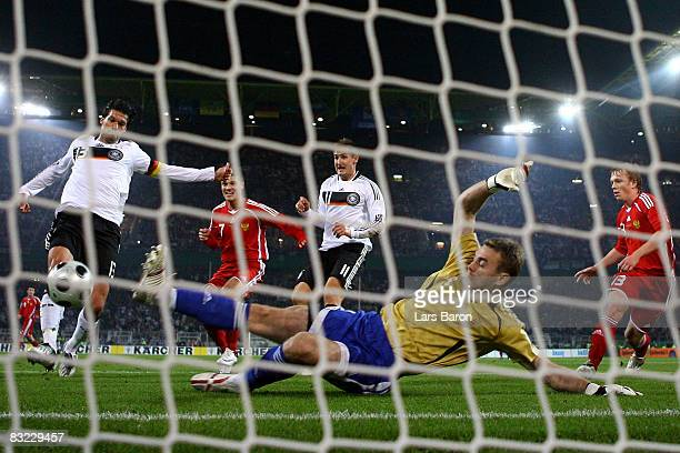 Michael Ballack of Germany scores the second goal past goalkeeper Igor Akinfeev of Russia during the FIFA 2010 World Cup Group Four Qualifying match...