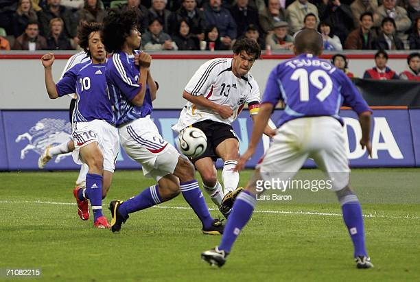 Michael Ballack of Germany shoots on goal during the international friendly match between Germany and Japan at the BayArena on May 30, 2006 in...