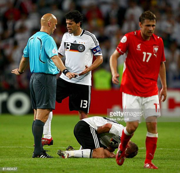 Michael Ballack of Germany talks to referee Tom Henning Ovrebo about a challenge on Lukas Podolski of Germany during the UEFA EURO 2008 Group B match...