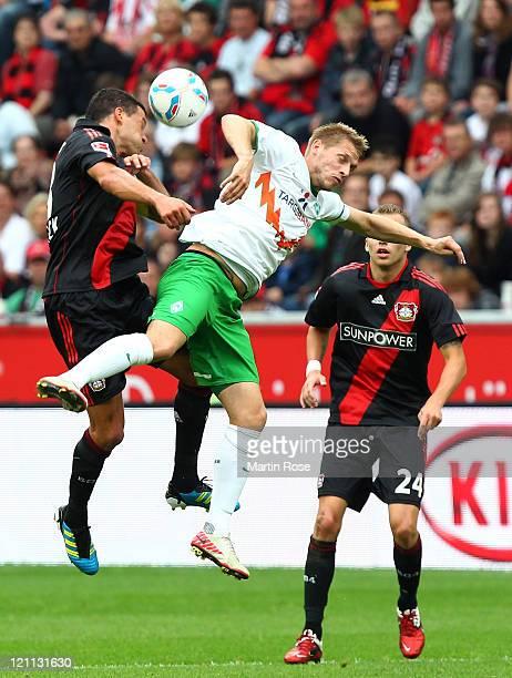 Michael Ballack of Leverkusen and aaron Hunt of Bremen head for the ball during the Bundesliga match between Bayer Leverkusen and SV Werder Bremen at...