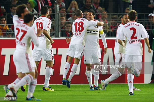Michael Ballack of Leverkusen celebrates his team's first goal with team mate Sidney Sam during the Bundesliga match between SC Freiburg and Bayer 04...