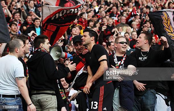 Michael Ballack of Leverkusen celebrates with the fans after winning the Bundesliga match between Bayer Leverkusen and FC Schalke 04 at BayArena on...