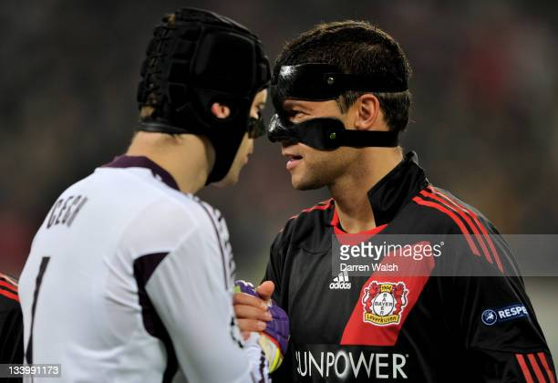 Michael Ballack of Leverkusen shakes hands with former Chelsea teammate goalkeeper Petr Cech prior to kickoff during the UEFA Champions League group...