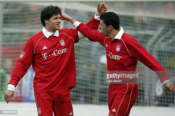Michael Ballack of Munich celebrates scoring the first goal with team mate Roy Makaay of Munich during the friendly match between KFC Uerdingen and...