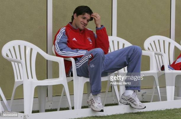 Michael Ballack of Munich watches the friendly match between Bayern Munich and FC Zuerich at the Dubai Sports Club as he sits out injured on January...