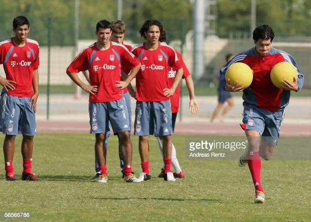 Michael Ballack runs with medicine balls in the morning session during the training camp of German Bundesliga club Bayern Munich on January 11 2006...