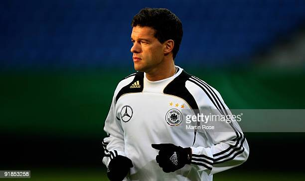 Michael Ballack warms up during the German National Team training session at the Hamburg Arena on October 13 2009 in Hamburg Germany