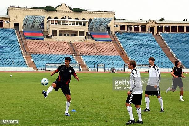 Michael Ballack warms up with team mates Philipp Lahm Arne Friedrich and Mario Gomez during the German National Team training session at the Hyatt...