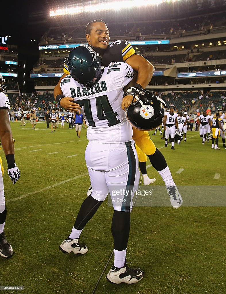 Michael Bamiro #74 of the Philadelphia Eagles and Miguel Maysonet #30 of the Pittsburgh Steelers greet eachother after their Pre Season game at Lincoln Financial Field on August 21, 2014 in Philadelphia, Pennsylvania. They were former roomates at Stony Brook University