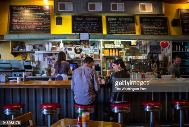 Michael Bancroft left and Francesca Chesler finish up a late lunch at the counter at Kuba Kuba For a travel piece on Richmond VA on April 8 2018