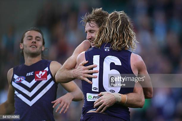 Michael Barlow and David Mundy of the Dockers celebrate a goal during the round 13 AFL match between the Fremantle Dockers and the Port Adelaide...