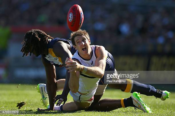 Michael Barlow of the Dockers handballs against Nic Naitanui of the Eagles during the round three AFL match between the West Coast Eagles and the...