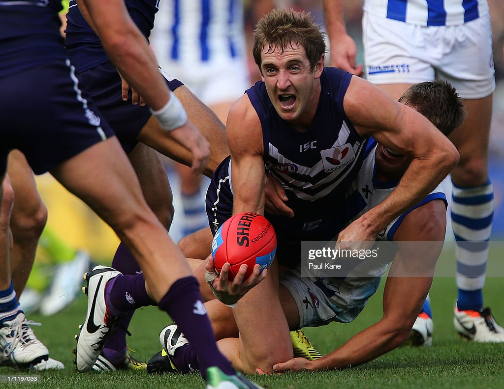 Michael Barlow of the Dockers looks to handball during the round 13 AFL match between the Fremantle Dockers and the North Melbourne Kangaroos at Patersons Stadium on June 23, 2013 in Perth, Australia.