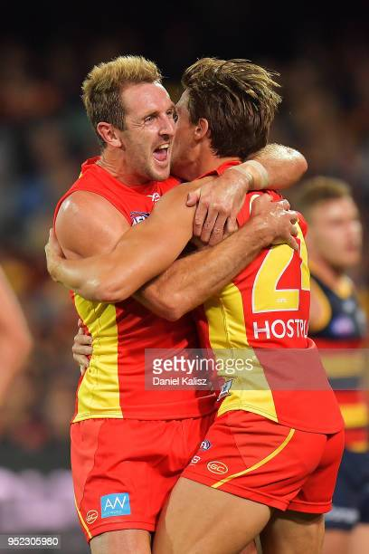 Michael Barlow of the Suns celebrates with David Swallow of the Suns during the round six AFL match between the Adelaide Crows and Gold Coast Suns at...