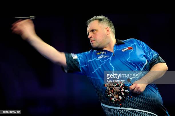 Michael Barnard of England in action against Jose De Souza of Portugal during Day Two of the 2019 William Hill World Darts Championship at Alexandra...