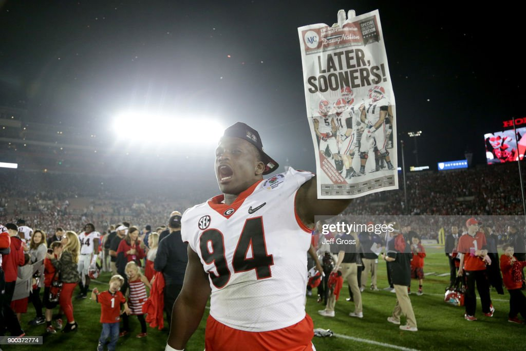 Michael Barnett #94 of the Georgia Bulldogs holds up a newspaper after the Bulldogs beat the Oklahoma Sooners 54-48 in the 2018 College Football Playoff Semifinal at the Rose Bowl Game presented by Northwestern Mutual at the Rose Bowl on January 1, 2018 in Pasadena, California.