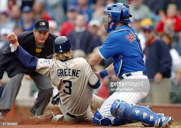 Michael Barrett of the Chicago Cubs tags out Khalil Greene of the San Diego Padres in the third inning on August 12, 2004 at Wrigley Field in...