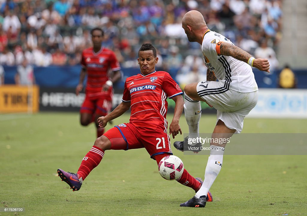 Michael Barrios #21 of FC Dallas blocks a clearing attempt by Jelle Van Damme #37 of the Los Angeles Galaxy during the MLS match at StubHub Center on October 23, 2016 in Carson, California.