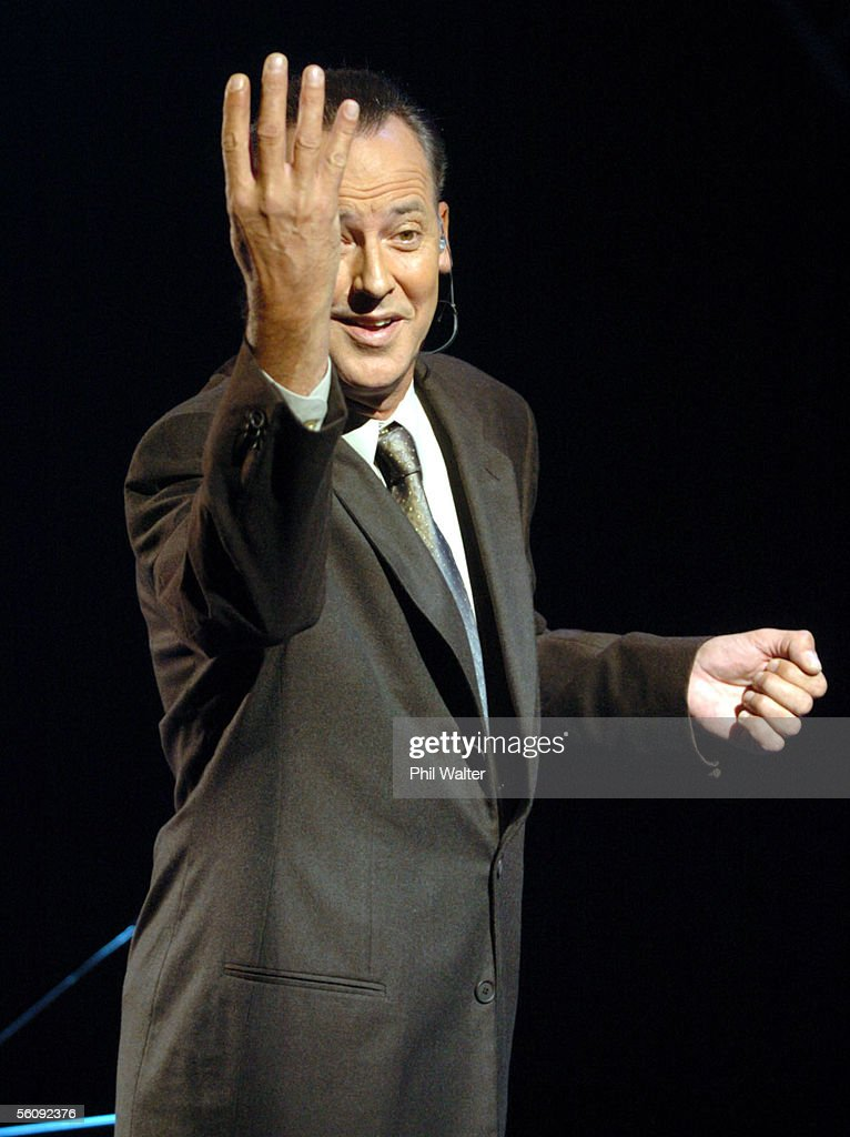 Michael Barrymore gives 'the fingers' to : News Photo