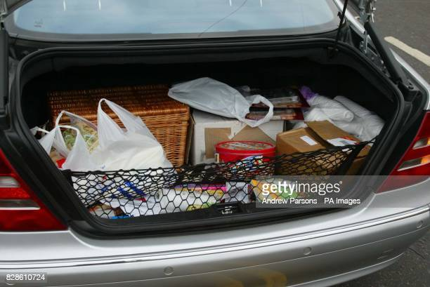 Michael Barrymore's car boot full of food and drinks as the entertainer arrives at the United Reformed Church Village Hall in Roydon Essex where he...