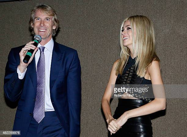 Michael Bay and Nicola Peltz attend the premiere of Paramount Pictures Transformers Age of Extinction at Cinepolis Lagoon on July 16 2014 in Rio de...