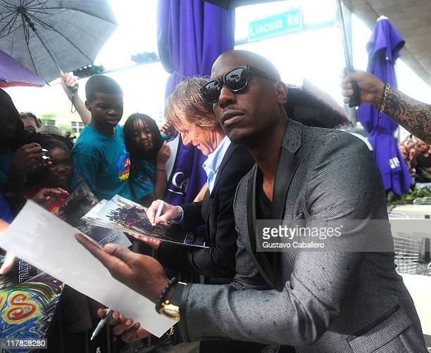 Michael Bay and Tyrese Gibson attends the Special Red Carpet VIP Screening of Transformers Dark of the Moon Arrivals at Regal South Beach on June 30...