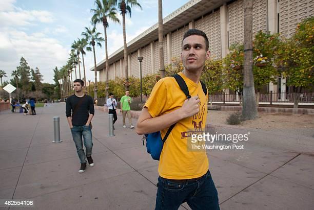 Michael Bayne walks around the Arizona State University campus in Tempe, Arizona, January 12, 2015. Bayne is a junior with scholarships, Pell grants,...