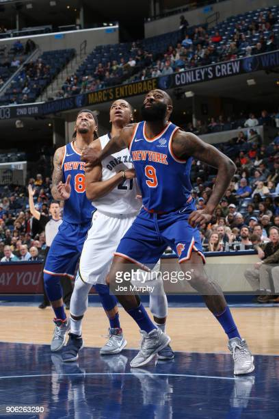 Michael Beasley and Kyle O'Quinn of the New York Knicks box out Deyonta Davis of the Memphis Grizzlies on January 17 2018 at FedExForum in Memphis...