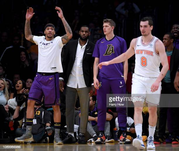 Michael Beasley LeBron James and Moritz Wagner of the Los Angeles Lakers react to a Laker goaltending behind Mario Hezonja of the New York Knicks...