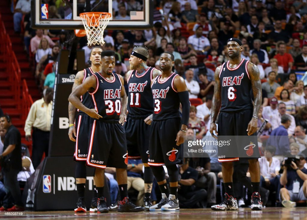 Michael Beasley #8, Norris Cole #30, Chris Andersen #11, Dwyane Wade #3 and LeBron James #6 of the Miami Heat look on during a game against the San Antonio Spurs at American Airlines Arena on January 26, 2014 in Miami, Florida.