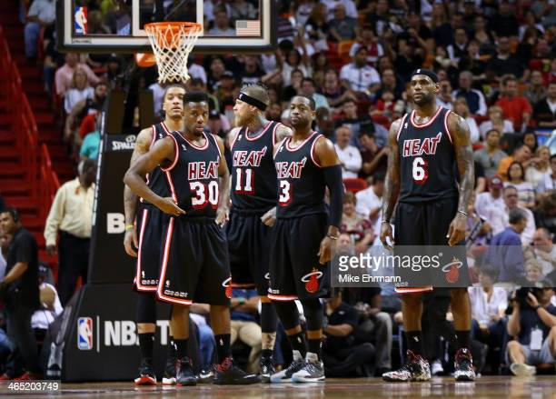 Michael Beasley Norris Cole Chris Andersen Dwyane Wade and LeBron James of the Miami Heat look on during a game against the San Antonio Spurs at...