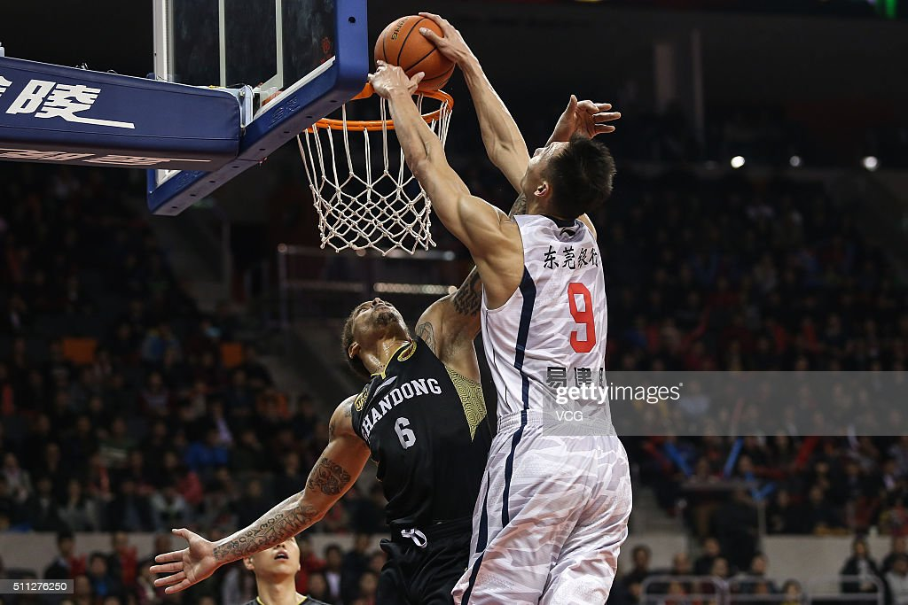 Michael Beasley #6 of Shandong Golden Stars defends against Yi Jianlian #9 of Guangdong Southern Tigers during the Chinese Basketball Association 15/16 season play-off quarter-final match between Guangdong Southern Tigers and Shandong Golden Stars at Dongguan Arena on February 19, 2016 in Dongguan, China.